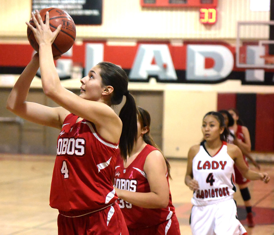 . Workman\'s Raquel Ramirez (4) drives to the basket against Gladstone in the first half of a prep basketball game at Gladstone High School in Covina, Calif., on Friday, Jan. 17, 2014. (Keith Birmingham Pasadena Star-News)