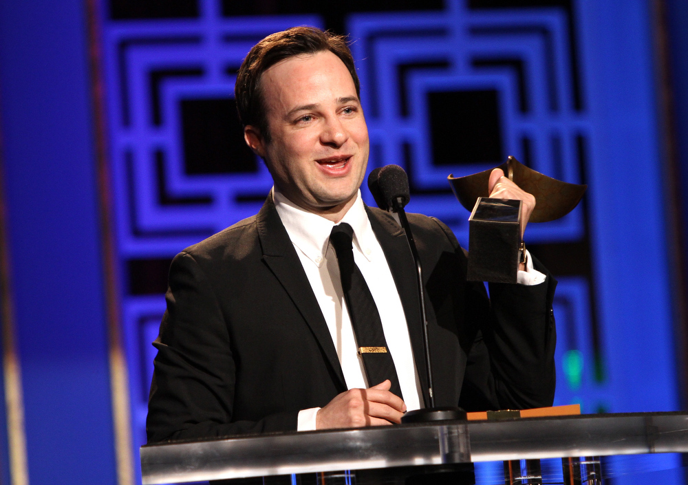 Description of . Writer Danny Strong accepts the Writers Guild Award for Outstanding Script Television, Adapted Long Form  onstage at the 2013 WGAw Writers Guild Awards at JW Marriott Los Angeles at L.A. LIVE on February 17, 2013 in Los Angeles, California.  (Photo by Maury Phillips/Getty Images for WGAw)