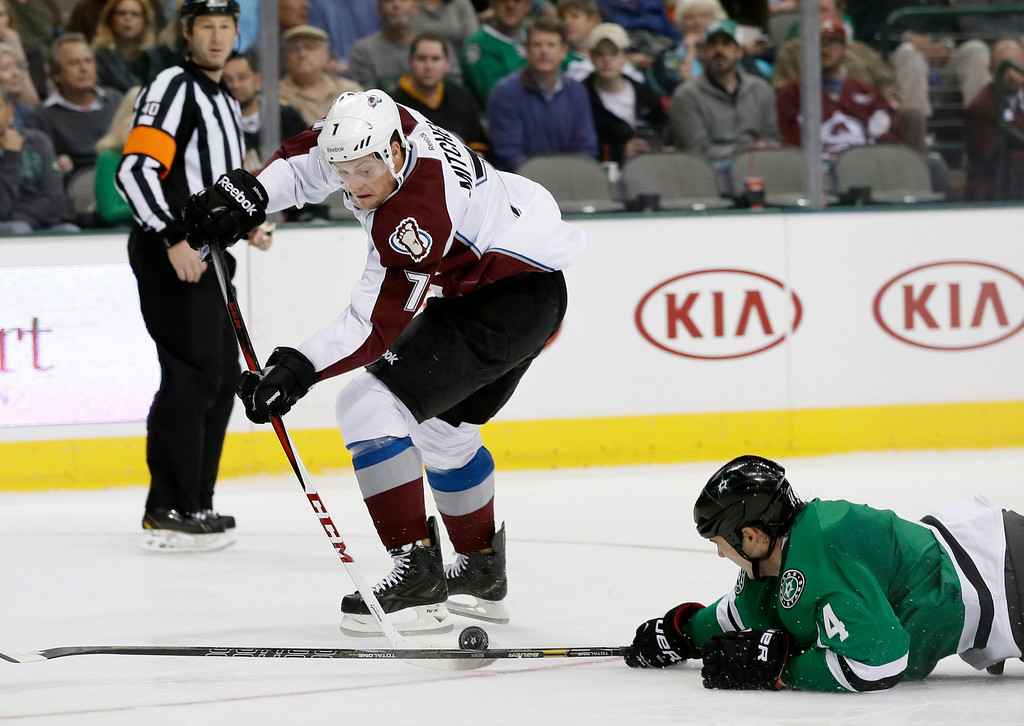 . Colorado Avalanche center John Mitchell (7) has his shot attempt on a breakaway disrupted by a diving Dallas Stars\' Jamie Benn (14) in the second period of an NHL hockey game, Friday, Nov. 1, 2013, in Dallas. (AP Photo/Tony Gutierrez)