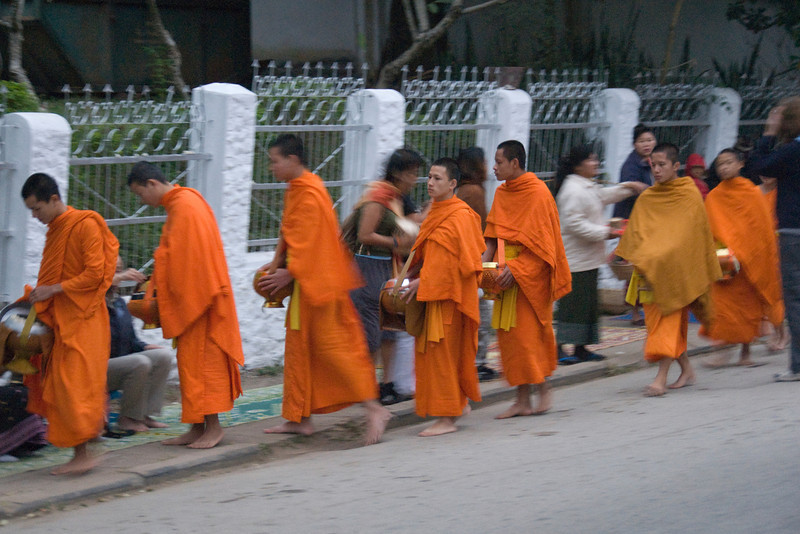 Monks collecting alms during ceremony at Luang Prabang, Laos