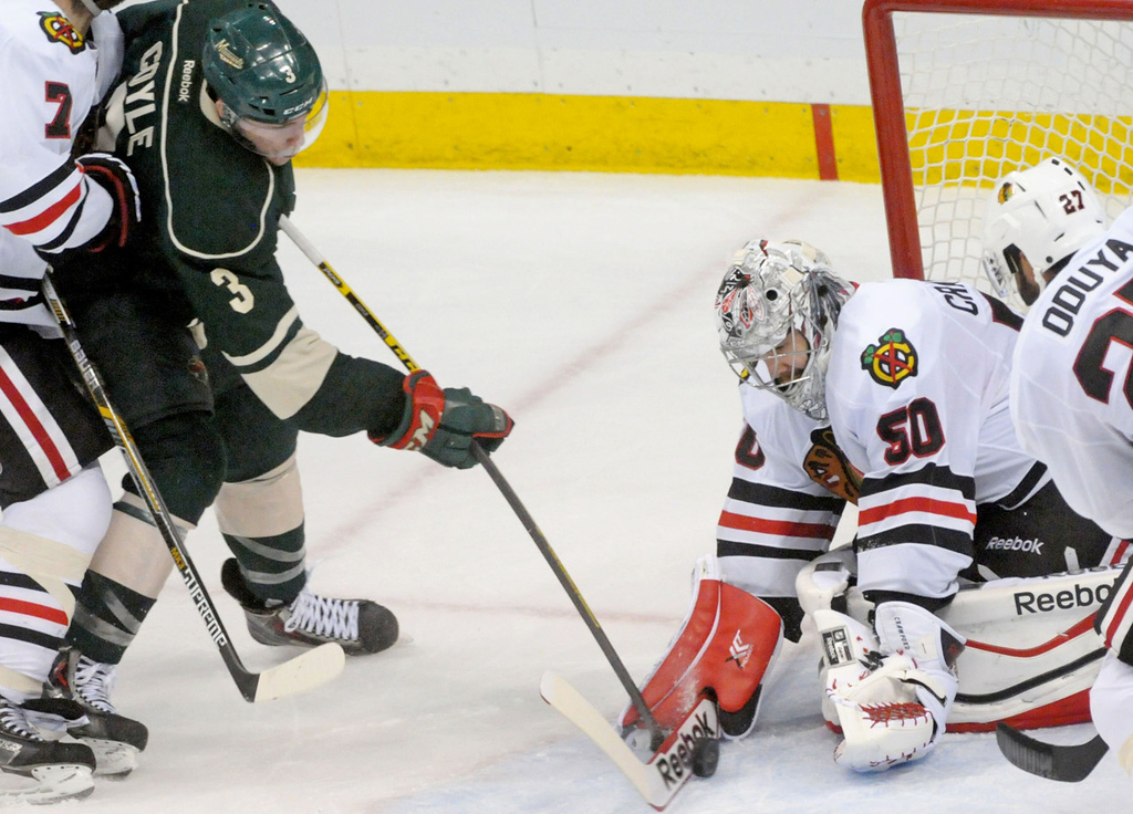 . Minnesota\'s Charlie Coyle makes an attempt to score on Blackhawks goalie Corey Crawford during the third period.   (Pioneer Press: Sherri LaRose-Chiglo)