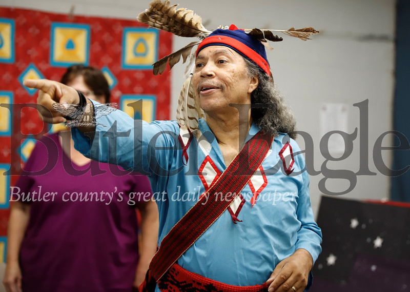 Miguel Sagne  of Pittsburgh calls for an answer to a trivia question dressed in a traditional Seneca garb at a presentation at the Zeilienople Library earlier this month. Sagne himself is a Cuban born descendent of the South American Taino tribe. Seb Foltz/Butler Eagle