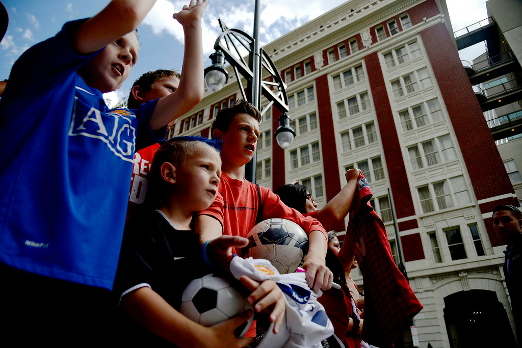 . DENVER, CO - JULY 24: Brothers from left to right, Brennon (11), Aydon (6) and Triston (14) Austin wait with fellow Manchester United fans for the squad to arrive at their hotel. Manchester United will play Italian squad Roma on Saturday, July 26 and arrived in Denver on Thursday, July 24, 2014. (Photo by AAron Ontiveroz/The Denver Post)