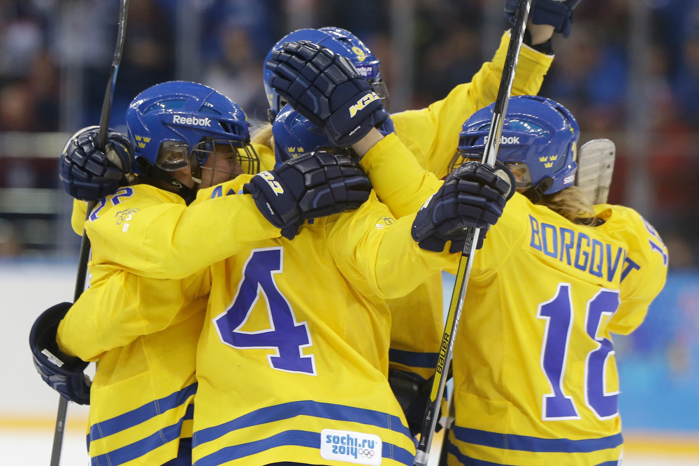 . Anna Borgqvist of Sweden (18) celebrates her goal against the United States with Team Sweden teammates during the third period of the 2014 Winter Olympics women\'s semifinal ice hockey game at Shayba Arena, Monday, Feb. 17, 2014, in Sochi, Russia. (AP Photo/Mark Humphrey)