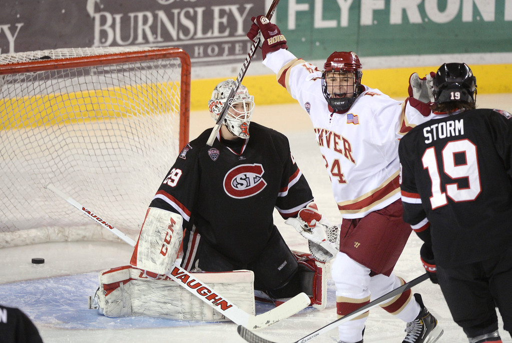 . DENVER, CO. - JANUARY 10:Denver right wing Evan Ritt (24) reacted to the Pioneers goal in the first period. The University of Denver hockey team hosted St. Cloud State at Magness Arena Friday night, January 10, 2014. Photo By Karl Gehring/The Denver Post