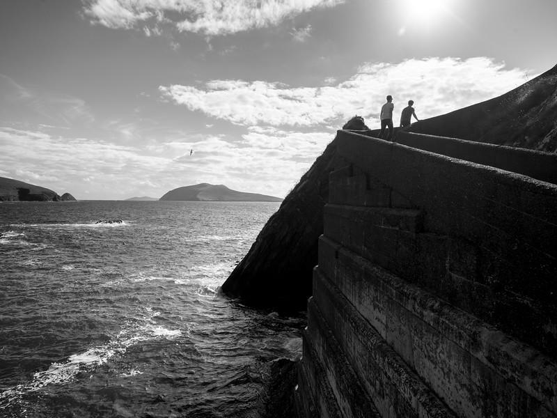 Hikers walking along Dunquin Pier, Ballyferriter, County Kerry, Ireland