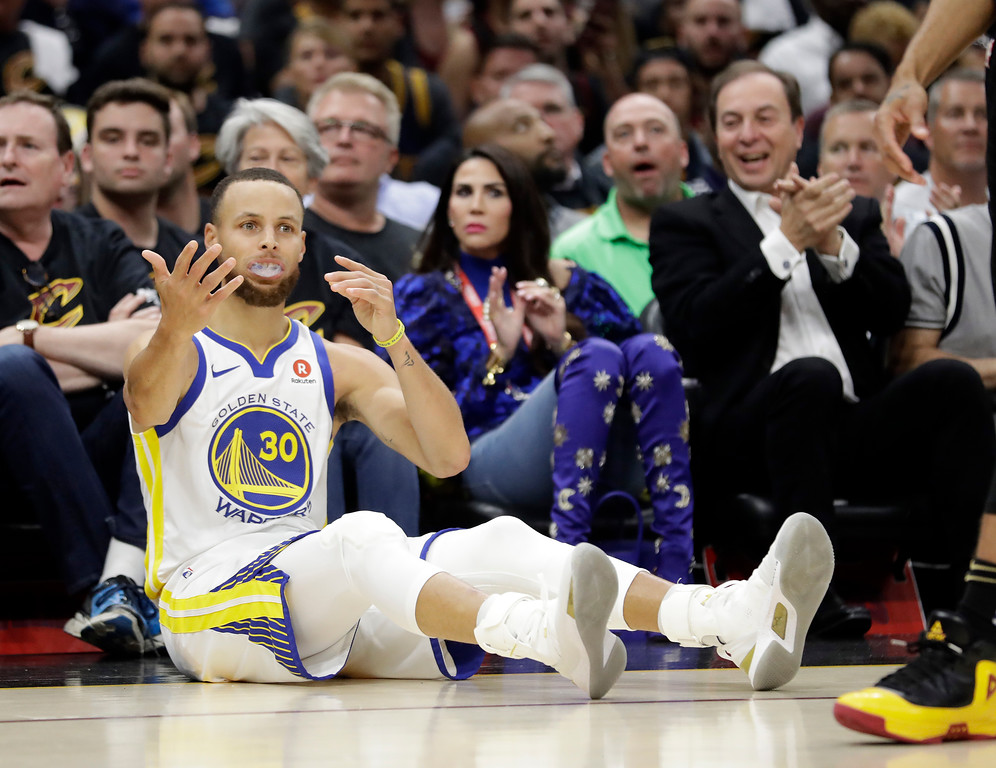 . Golden State Warriors\' Stephen Curry reacts to a call during the first half of Game 4 of basketball\'s NBA Finals against the Cleveland Cavaliers, Friday, June 8, 2018, in Cleveland. (AP Photo/Tony Dejak)