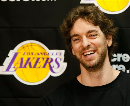 . Los Angeles Lakers power forward Pau Gasol smiles while talking to reporters during an NBA basketball news conference in El Segundo, Calif., Tuesday, April 30, 2013. The Lakers lost their first-round playoff series to the San Antonio Spurs. (AP Photo/Damian Dovarganes)