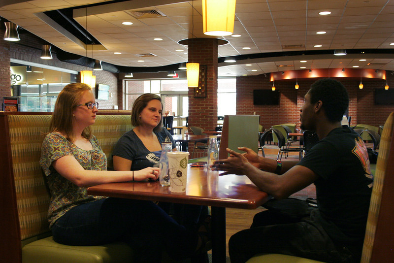 Students talk downstairs in the Tucker Student Center.
