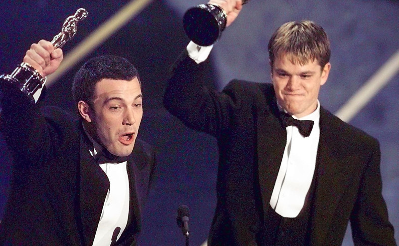 ". Ben Affleck (L) and Matt Damon hold up their Oscars after winning in the Original Screenplay  Category during the 70th Academy Awards at the Shrine Auditorium 23 March. The two won for their Original Screenplay ""Good Will Hunting.\""  TIMOTHY A. CLARY/AFP/Getty Images"