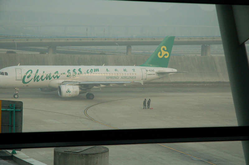 Two Chinese guys from the aiport crew waving goodbye