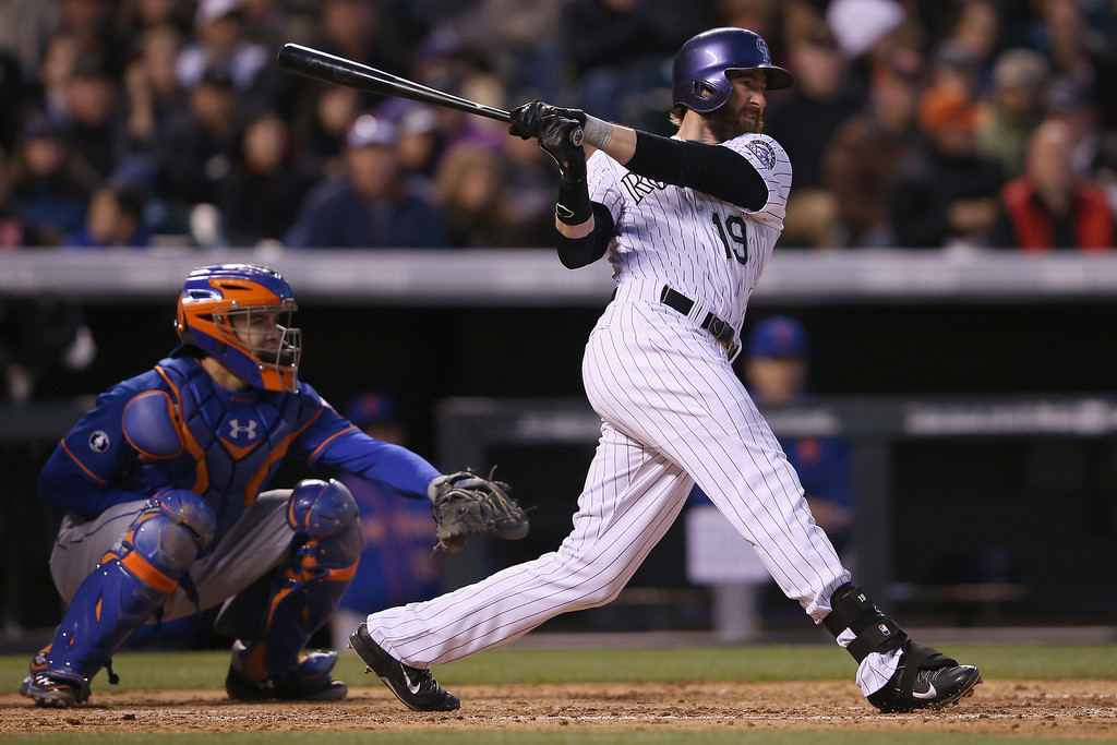 . Charlie Blackmon #19 of the Colorado Rockies hits an RBI single off of starting pitcher Bartolo Colon #40 of the New York Mets to score Corey Dickerson #6 of the Colorado Rockies and take a 5-0 lead in the fourth inning at Coors Field on May 1, 2014 in Denver, Colorado.  (Photo by Doug Pensinger/Getty Images)