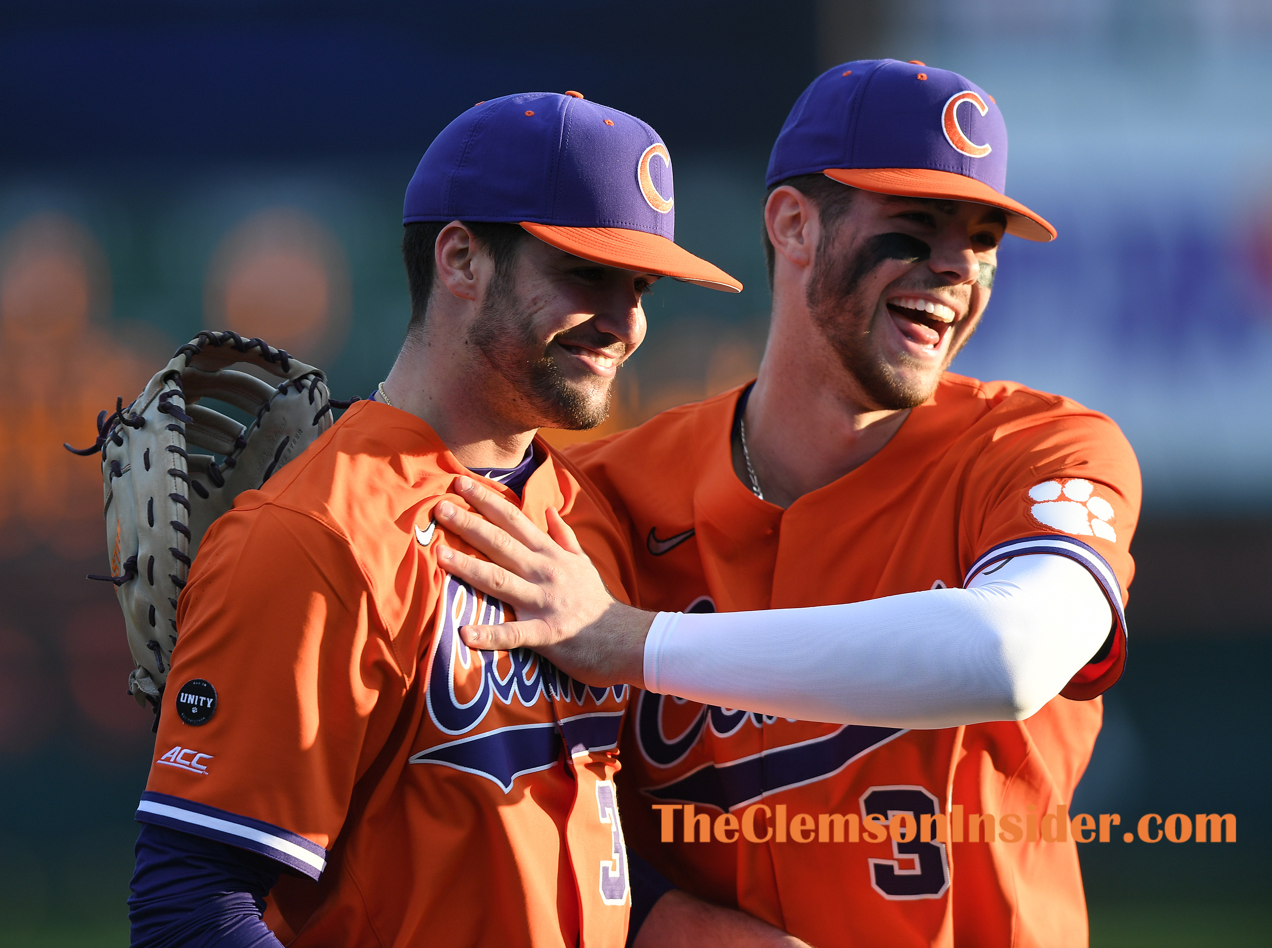 Clemson DH Davis Sharpe (30) is congratulated by teammate pitcher Caden Grice (31) as he leaves the game against Cincinnati during the Tiger's home opener on Friday, February 19, 2021 at Clemson's Doug Kingsmore Stadium. Bart Boatwright/The Clemson Insider