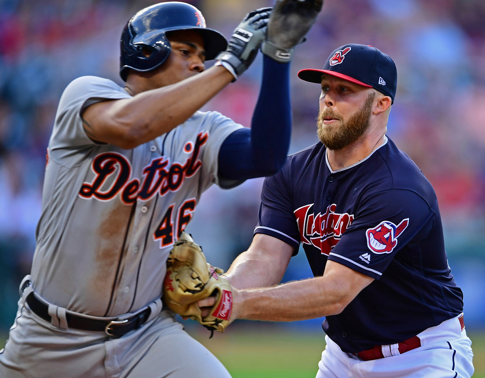 . Cleveland Indians relief pitcher Cody Allen tags out Detroit Tigers\' Jeimer Candelario in the eighth inning of a baseball game, Saturday, Sept.15, 2018, in Cleveland. The Cleveland Indians won 15-0. (AP Photo/David Dermer)
