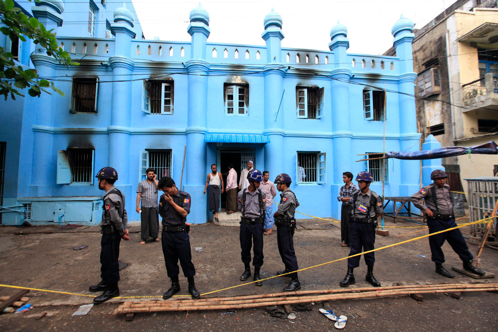 . Police stand in front of a mosque and school dormitory that were damaged by a fire in Yangon on April 2, 2013. An electrical fire at an Islamic school in Myanmar\'s biggest city killed 13 children early on Tuesday, authorities said. The children, all boys, died of suffocation in the fire at the dormitory of a school next to the mosque in Yangon at about 2:40 a.m., neighbors and officials said. REUTERS/Soe Zeya Tun