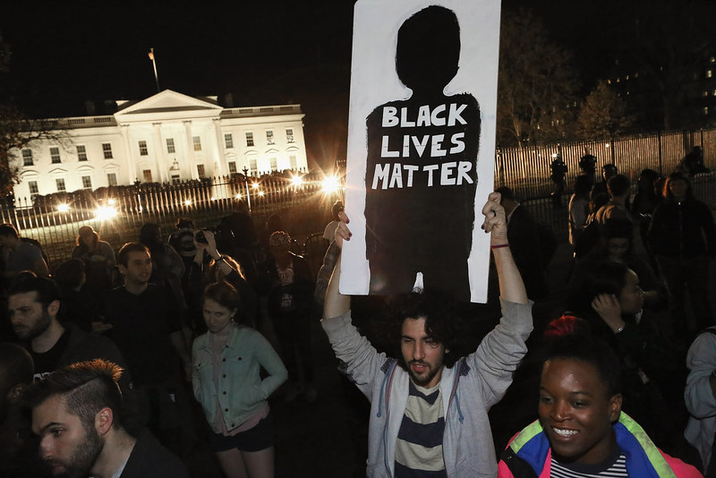 . Hundreds of demonstrators gather outside the White House to protest after the Ferguson grand jury decision in Missouri November 24, 2014 in Washington, DC. A St. Louis County grand jury has decided to not indict Ferguson police Officer Darren Wilson in the shooting death of Michael Brown that sparked riots in Ferguson, Missouri in August.  (Photo by Chip Somodevilla/Getty Images)