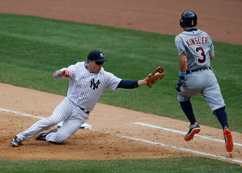 . New York Yankees first baseman Mark Teixeira (25) prepares to tag Detroit Tigers Ian Kinsler (3) on a sixth-inning groundout in a baseball game at Yankee Stadium in New York, Sunday, June 21, 2015.  (AP Photo/Kathy Willens)