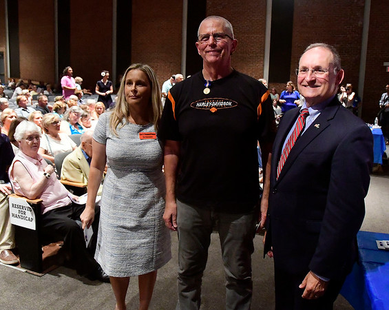 8/2/2018 Mike Orazzi | Staff Bryon Rankin (center) and state rep Cara Pavalock-DAmato and State Senator Henri Martin during the Connecticut Wartime Service Medal presentation ceremony at Bristol Eastern High School Thursday afternoon. Connecticut veterans who served 90 or more days of active federal wartime service - unless the war or operation lasted less than 90 days - or any member of any reserve component of the armed forces, including the National Guard, who served during a period of war and was honorably discharged from active duty or was honorably discharged from a reserve component and was a resident of this state either at the time he or she was serving or is living in this state on the date of such award.