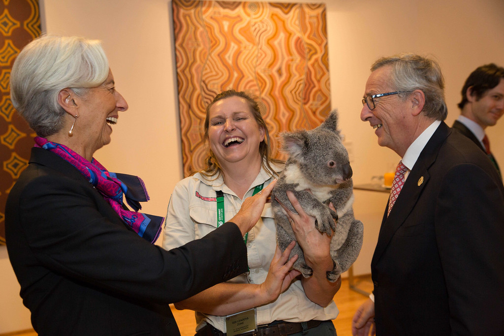 . This handout photo taken and released by G20 Australia on November 15, 2014 shows IMF Managing Director Christine Lagarde (L) pating Jimbelung the koala held by Michele Barneds (C) as European Commission President Jean-Claude Juncker looks on during the G20 Summit in Brisbane.  Australia is hosting the leaders of the world\'s 20 biggest economies for the G20 summit in Brisbane on November 15 and 16.. Australia is hosting the leaders of the world\'s 20 biggest economies for the G20 summit in Brisbane on November 15 and 16. AFP PHOTO / ANDREW TAYLOR /G20/Getty Images