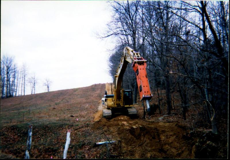 NPK E260A hydraulic hammer on Cat excavator 12-10-99 (2).JPG