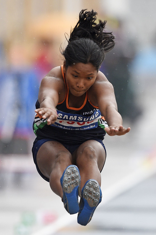 . India\'s Swapna Barman competes in the women\'s heptathlon long jump athletics event during the 17th Asian Games at the Incheon Asiad Main Stadium in Incheon on September 29, 2014. MARTIN BUREAU/AFP/Getty Images
