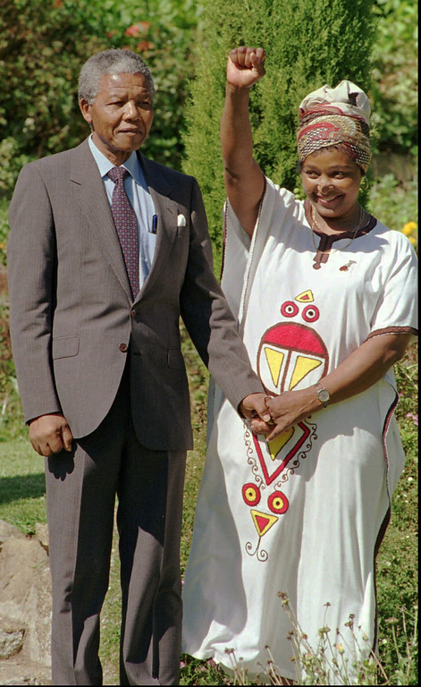 . Nelson Mandela, left, African National Congress leader, holds hands with his wife, Winnie Mandela, giving the Amandla salute, in the garden of Archbishop Desmond Tutu\'s residence, Cape Town, South Africa on Monday, February 14, 1990. Mandela was released from prison yesterday after serving 27 years.  (AP Photo/Adil Bradlow)