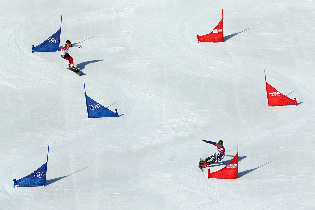 . SOCHI, RUSSIA - FEBRUARY 22: Matthew Morison of Canada (L) and Vic Wild of Russia compete in the Snowboard Men\'s Parallel Slalom Qualification on day 15 of the 2014 Winter Olympics at Rosa Khutor Extreme Park on February 22, 2014 in Sochi, Russia.  (Photo by Cameron Spencer/Getty Images)