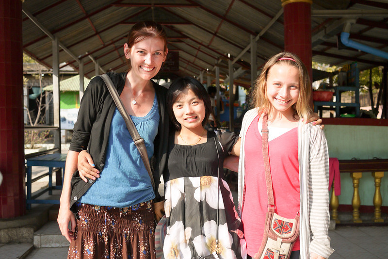 Taking our photo with friendly locals on Mandalay Hill, Burma.