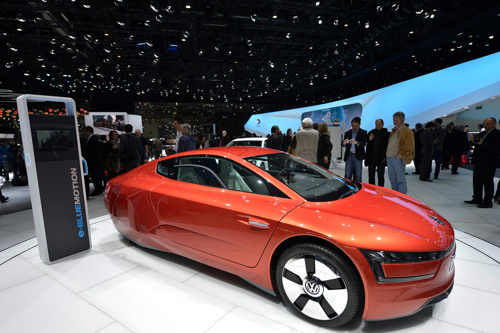 . The new Volkswagen VW Prototype XL1 is shown during the press day at the 83rd Geneva International Motor Show in Geneva, Switzerland, Tuesday, March 5, 2013. The Motor Show will open its gates to the public from 7th to 17th March presenting more than 260 exhibitors and more than 130 world and European premieres. (AP Photo/Keystone, Martial Trezzini)