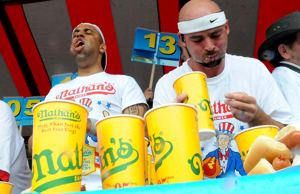 ". 10. (tie) HOT DOG EATING CONTESTS <p>Is that four wieners in your cheeks, or are you just happy to see me? (10) <p><b><a href=\'http://www.twincities.com/localnews/ci_25876762/st-pauls-grand-old-day-hot-dog-eating\' target=""_blank\""> LINK </a></b> <p>    (Pioneer Press: Sherri LaRose-Chiglo)"