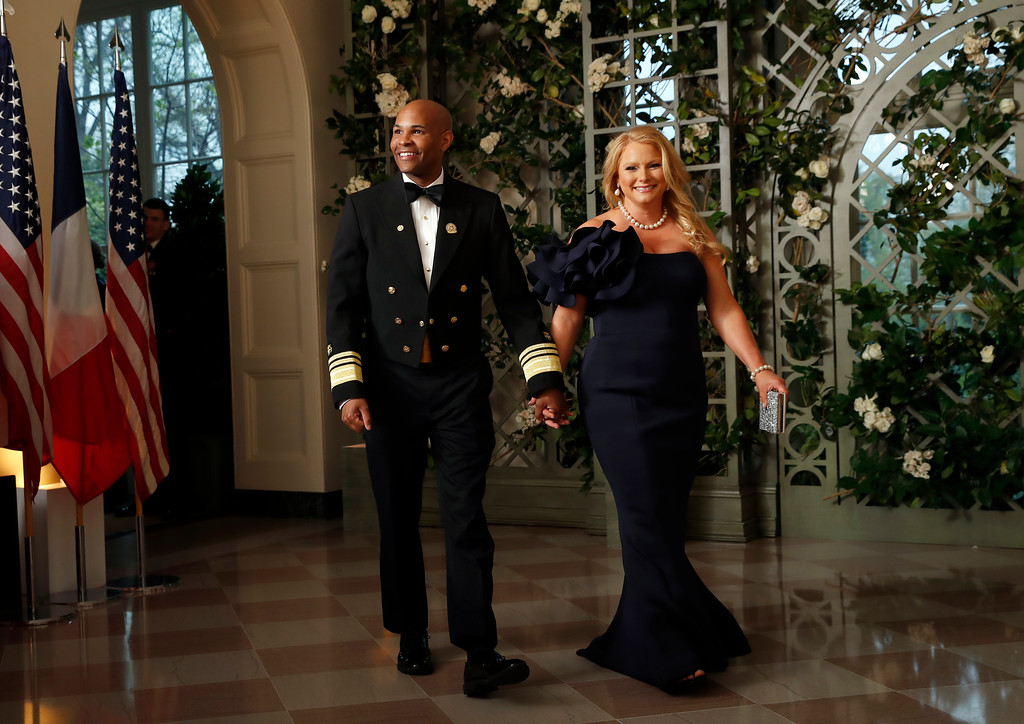 . Jerome Adams, Surgeon General, and Lacey Adams arrive for a State Dinner with French President Emmanuel Macron and President Donald Trump at the White House, Tuesday, April 24, 2018, in Washington. (AP Photo/Alex Brandon)