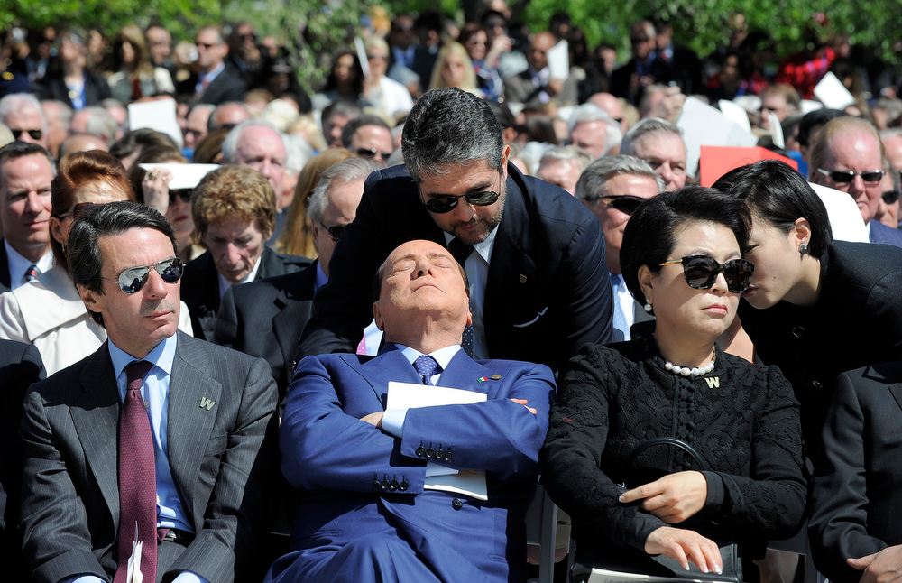 Description of . Former Prime Minister of Italy Silvio Berlusconi (C) attends the George W. Bush Presidential Center dedication ceremony in Dallas, Texas, on April 25, 2013.  JEWEL SAMAD/AFP/Getty Images