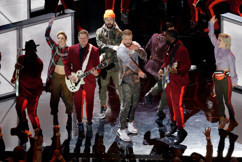 . Justin Timberlake, center, performs during halftime of the NFL Super Bowl 52 football game Sunday, Feb. 4, 2018, in Minneapolis. (AP Photo/Eric Gay)