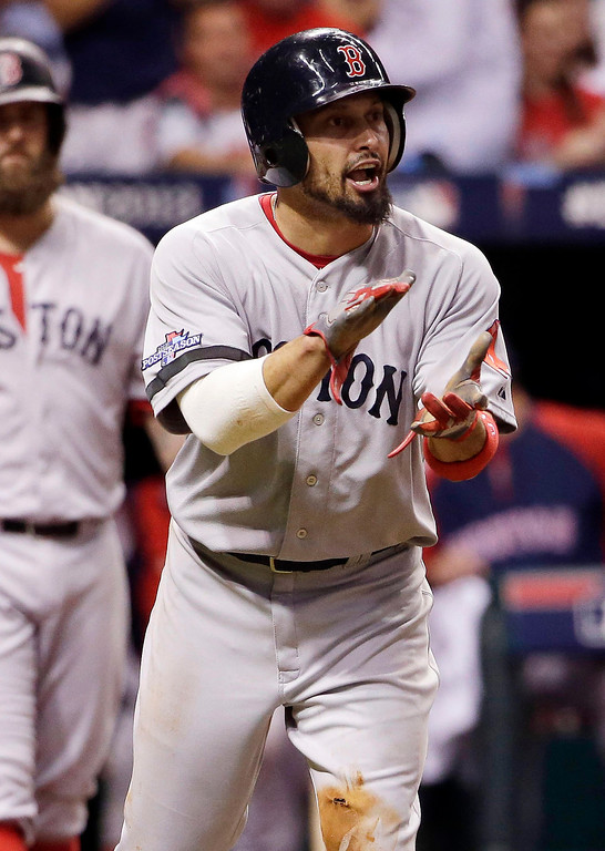 . Boston Red Sox\'s Shane Victorino applauds teammate David Ortiz after Victorino scored on a hit by Ortiz in the fifth inning in Game 3 of an American League baseball division series against the Tampa Bay Rays, Monday, Oct. 7, 2013, in St. Petersburg, Fla. (AP Photo/Chris O\'Meara)