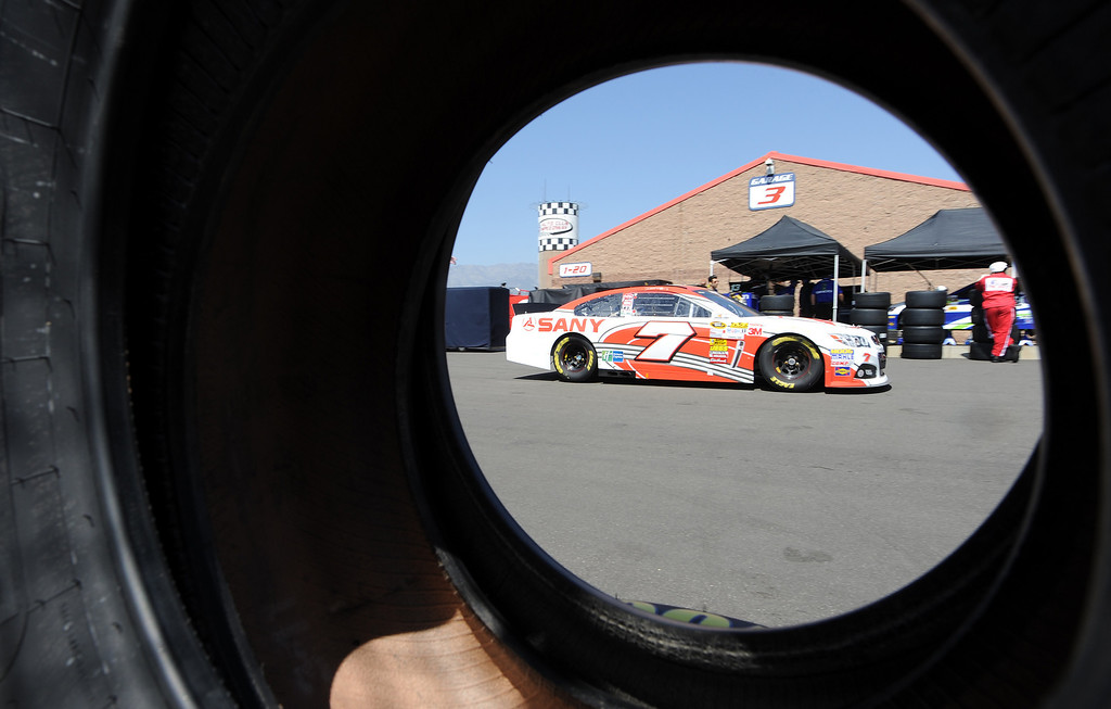 . (Will Lester/Staff Photographer) NASCAR driver Dave Blaney leaves the garage for practice Friday. Drivers and fans at Auto Club Speedway in Fontana for the opening practice session for Sunday\'s Auto Club 400 Friday March 22, 2013.