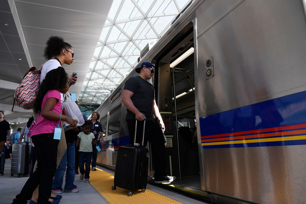. Train passengers load up on the RTD University of Colorado A-Line train at Denver International Airport April 22, 2016. (Photo by Andy Cross/The Denver Post)