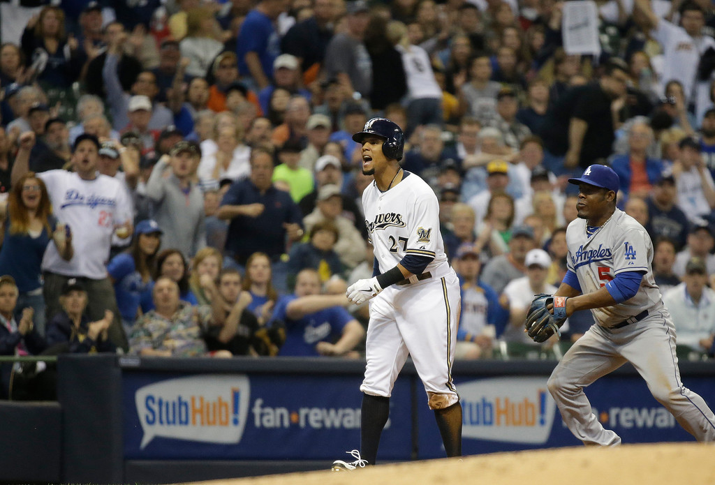 . Milwaukee Brewers\' Carlos Gomez reacts after being thrown out at third during the second inning of a baseball game against the Los Angeles Dodgers Wednesday, May 22, 2013, in Milwaukee. (AP Photo/Morry Gash)