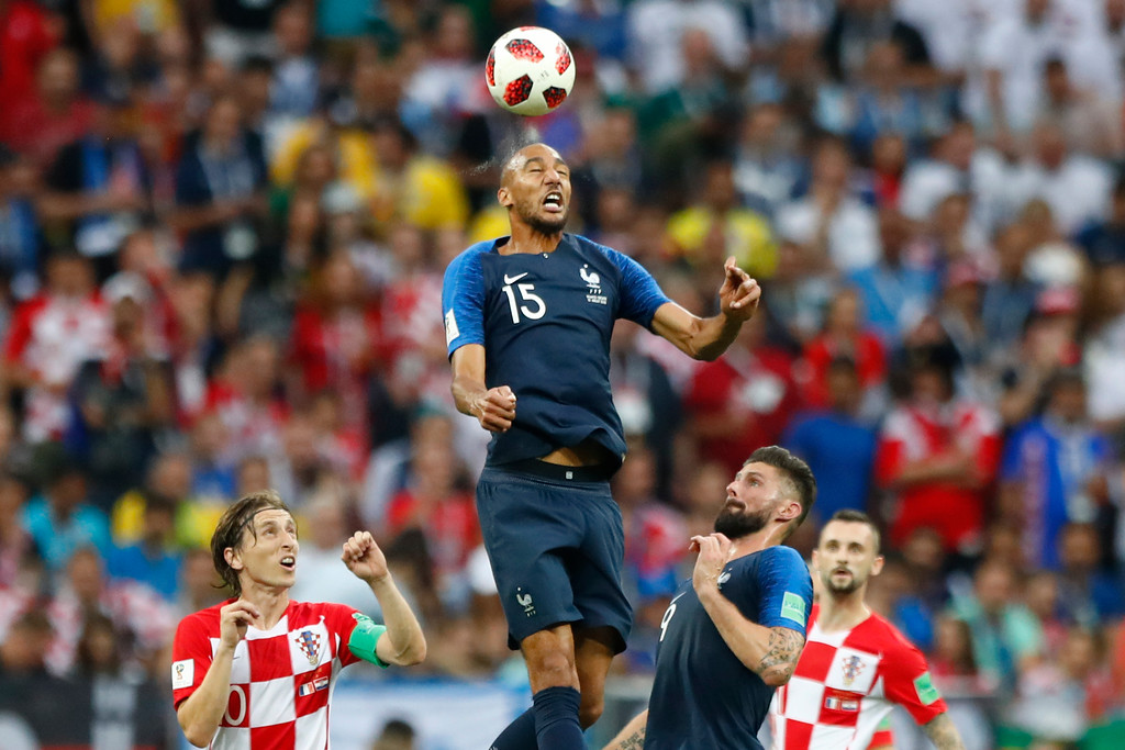 . France\'s Steven Nzonzi heads the ball during the final match between France and Croatia at the 2018 soccer World Cup in the Luzhniki Stadium in Moscow, Russia, Sunday, July 15, 2018. (AP Photo/Matthias Schrader)