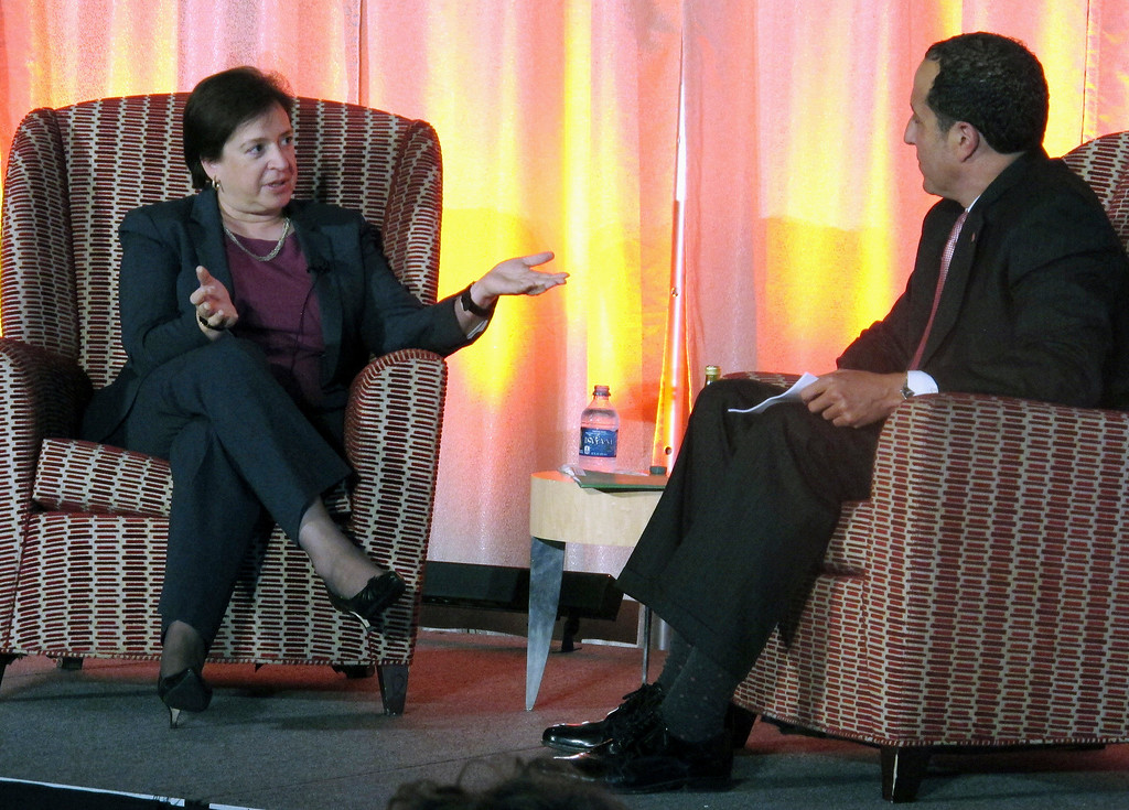 """. Supreme Court Justice Elena Kagan talks about her work on the court after stints as Harvard Law School dean and U.S. Solicitor General, in a conversation with Ohio State University law school dean Alan Michaels, Wednesday, Sept. 30, 2015, in Columbus, Ohio. Kagan said she stands \""""on the shoulders\"""" of former Justice Sandra Day O\'Connor and fellow justice Ruth Bader Ginsburg. (AP Photo/Andrew Welsh-Huggins)"""