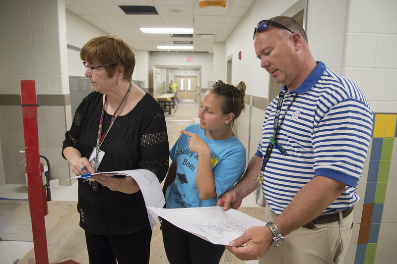 06/12/19  Wesley Bunnell | Staff  CSDNB Facilities Specialist Gayle West, L, looks over a school map with fifth grade teacher Chantelle Morin, M, and fifth grade teacher Steve Gray during a walkthrough of Smalley School on June 12, 2019. The walk through allowed teachers and administrators their first glimpse of the renovations and additions which are scheduled for completion in August.