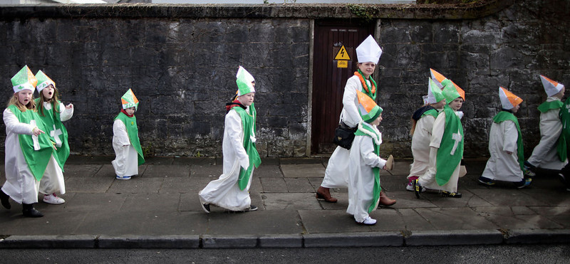 . Children dressed as Saint Patrick make their way to the St. Patrick\'s Day parade in Limerick, Ireland, Sunday, March 17, 2013.  (AP Photo/Peter Morrison)