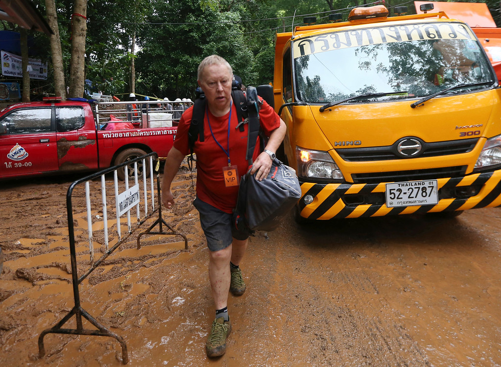 . British Cave Rescue Council member Robert Charles Harper arrives in Mae Sai, Chiang Rai province, in northern Thailand, Tuesday, July 3, 2018. The 12 boys and soccer coach found in a partially flooded cave in northern Thailand after 10 days are mostly in stable medical condition and have received high-protein liquid food, officials said Tuesday, though it is not known when they will be able to go home. (AP Photo/Sakchai Lalit)