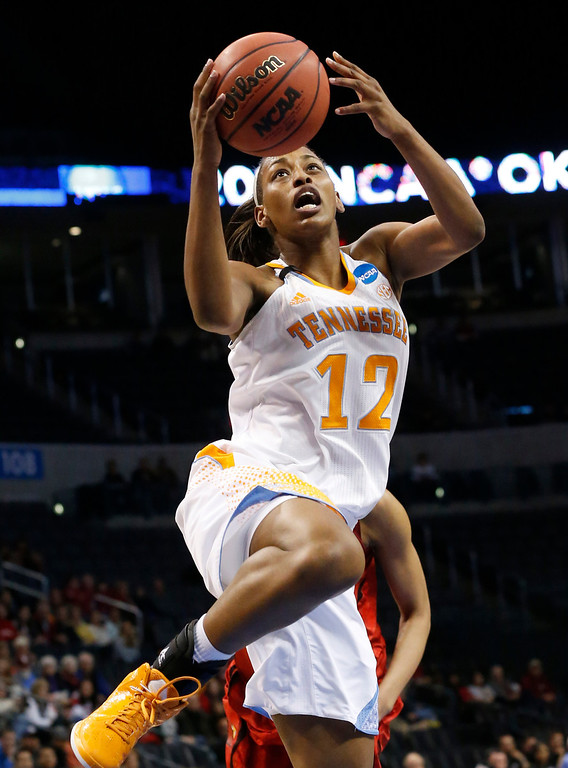 . Tennessee forward Bashaara Graves (12) goes up for a shot in front of Louisville center Sheronne Vails in the first half of the Oklahoma City regional final in the NCAA women\'s college basketball tournament in Oklahoma City, Tuesday, April 2, 2013. (AP Photo/Sue Ogrocki)