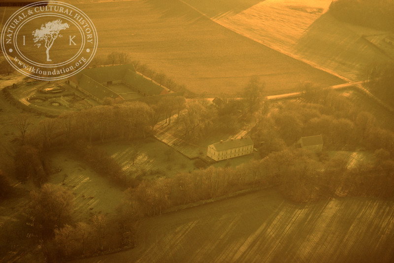 Araslöv manor house and church with farmland. Experimentally photographed with yellow filter (19 November, 1988). | LH.0234