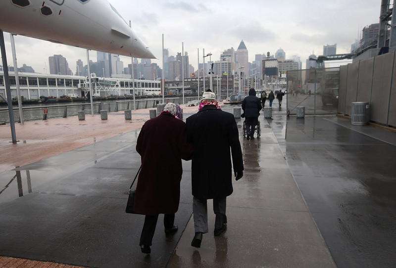 . Pearl Harbor survivor Aaron Chabin (R), 89, walks with his wife of 58 years Helene Chabin after attending a ceremony commemorating the 71st anniversary of the Japanese attacks on Pearl Harbor on December 7, 2012 in New York City. World War II veterans from the New York metropolitan area participated in a wreath-laying ceremony next to the Intrepid Sea, Air and Space Museum, which was damaged in Hurricane Sandy and is undergoing repairs.  (Photo by John Moore/Getty Images)