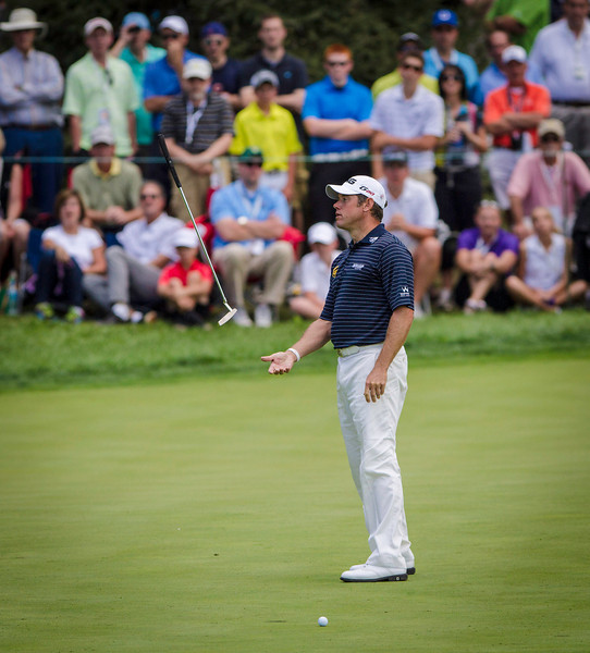 Lee Westwood flips his putter in the air after missing a birdie putt on the 6th hole during the final day of the 2012 BMW Championship at Crooked Stick Golf Course in Carmel Indiana on Sunday Sept. 9, 2012 (Charles Cherney/WGA)