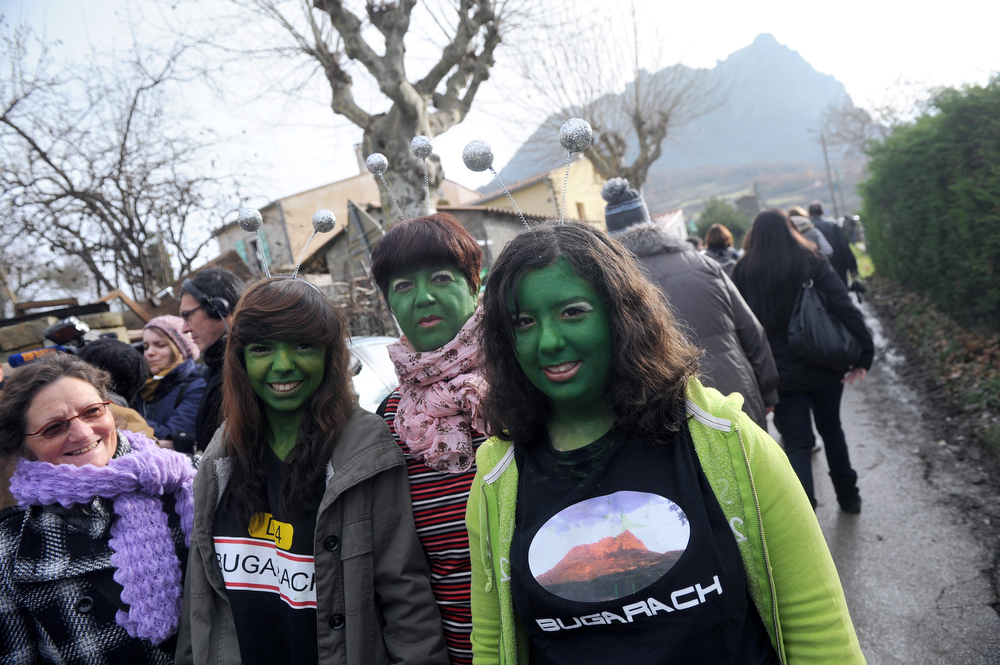 Description of . Women with their faces painted in green walk on December 21, 2012 in the French southwestern village of Bugarach, near the 1,231 meter high peak of Bugarach - one of the few places on Earth some believe will be spared when the world allegedly ends today according to claims regarding the ancient Mayan calendar. French authorities have pleaded with New Age fanatics, sightseers and media crews not to converge on the tiny village.  ERIC CABANIS/AFP/Getty Images