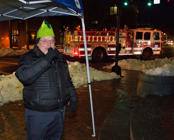 12/05/19 Wesley Bunnell | StaffrrThe New Britain Christmas tree was lit on Thursday night in Central Park complete with a visit from Santa Clause who rode in on a NBFD fire truck. Downtown District Executive Director Gerry Amodio announces Santas arrival at Central park.