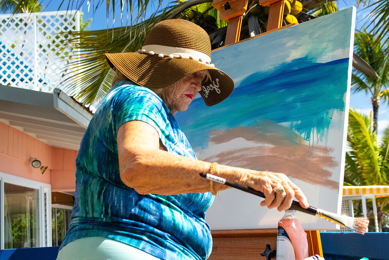 Rosemary Miller is a famous artist who works in 12 different medians.  Here she is working in oil on a seascape.  She feels so alive when she is working outside.