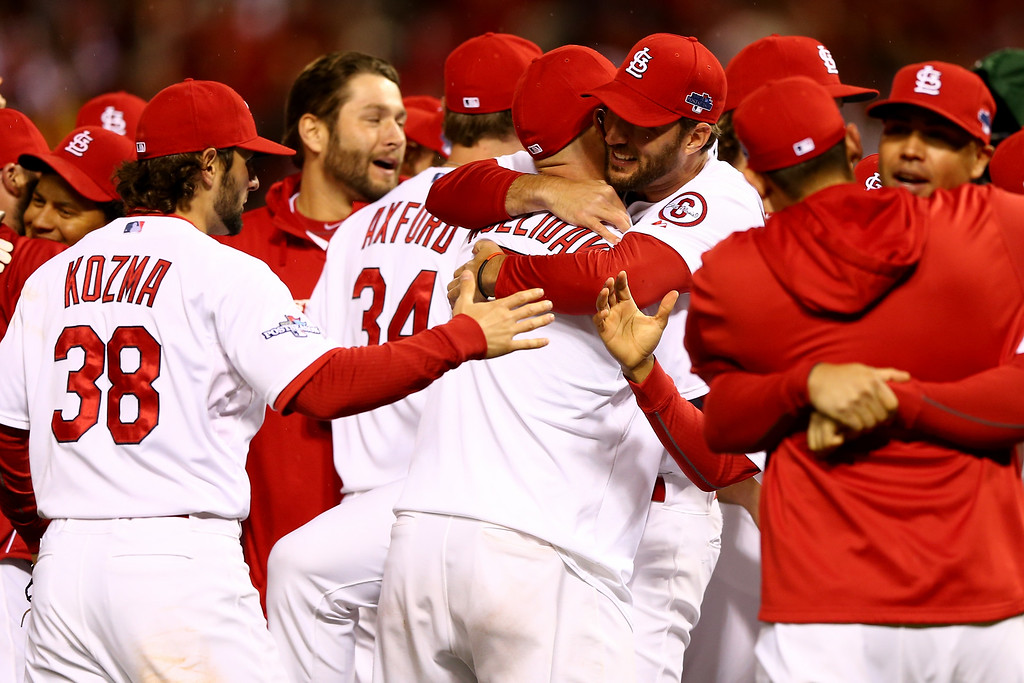 . ST LOUIS, MO - OCTOBER 18:  The St. Louis Cardinals celebrate after defeating the Los Angeles Dodgers 9-0 in Game Six of the National League Championship Series at Busch Stadium on October 18, 2013 in St Louis, Missouri.  (Photo by Elsa/Getty Images)